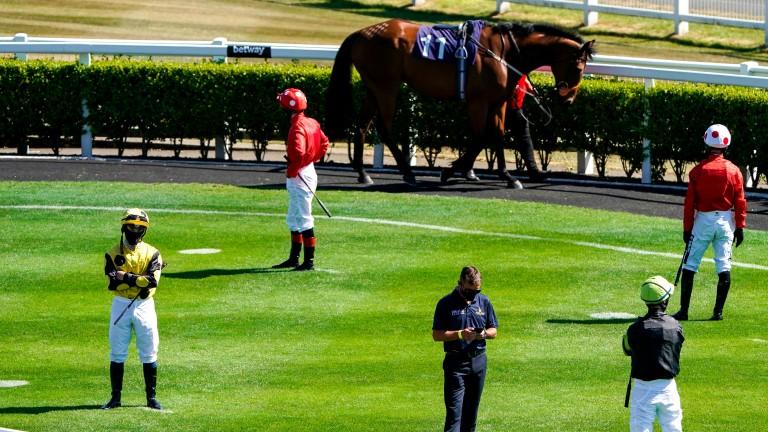 Jockeys observe social distancing in the parade ring at Newcastle