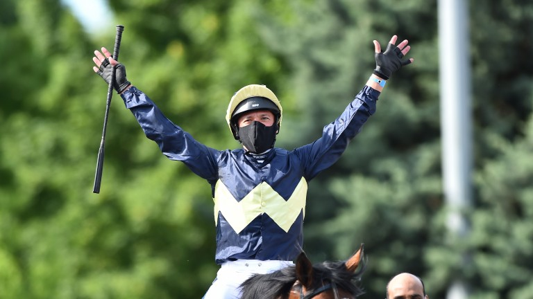 A masked Frankie Dettori celebrates his win on Galsworthy at Kempton