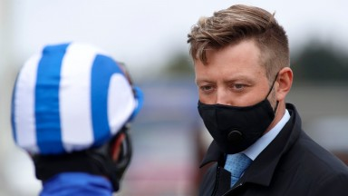 YARMOUTH, ENGLAND - JUNE 03: Charlie Johnston speaks with Dane O'Neill after winning The Betway Heed Your Hunch Handicap Stakes at Yarmouth Racecourse on June 03, 2020 in Yarmouth, England. (Photo by Dan Abraham/Pool via Getty Images)