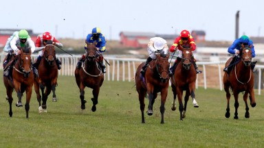 The Lir Jet (centre, light colours) makes a winning debut for trainer Michael Bell at Yarmouth