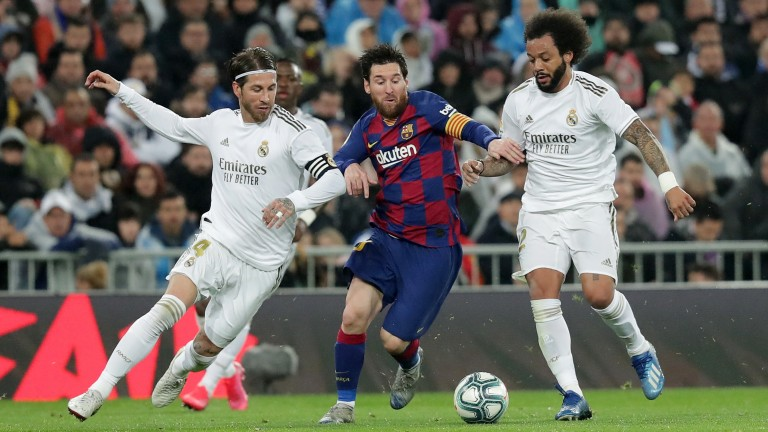 Lionel Messi of Barcelona is challenged by Real Madrid's Sergio Ramos  (left) and Marcelo in March's La Liga clash