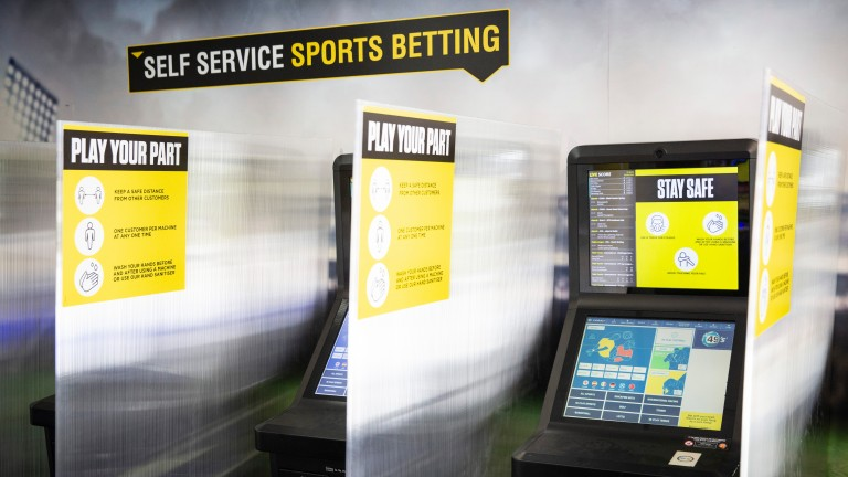Dividers have been placed between betting shop terminals