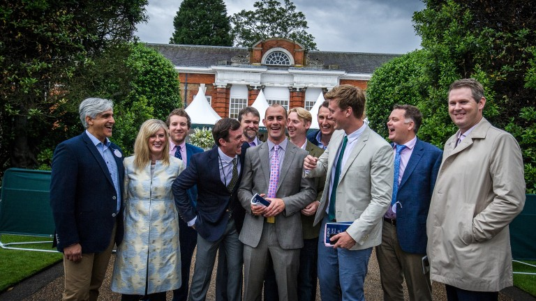 Jet Setting's connections in celebratory mood after the filly sold to Michael Wallace (right) of the China Horse Club at the Goffs London Sale