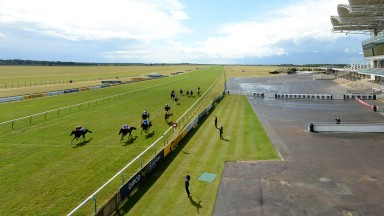 A general view of empty stands as Kameko lands the 2,000 Guineas  (Photo by Edward Whitaker/Pool via Getty Images)