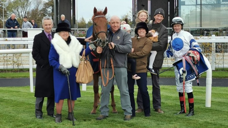 Nicky Teehan (second right) celebrates Ten Year Ticket's debut victory with family