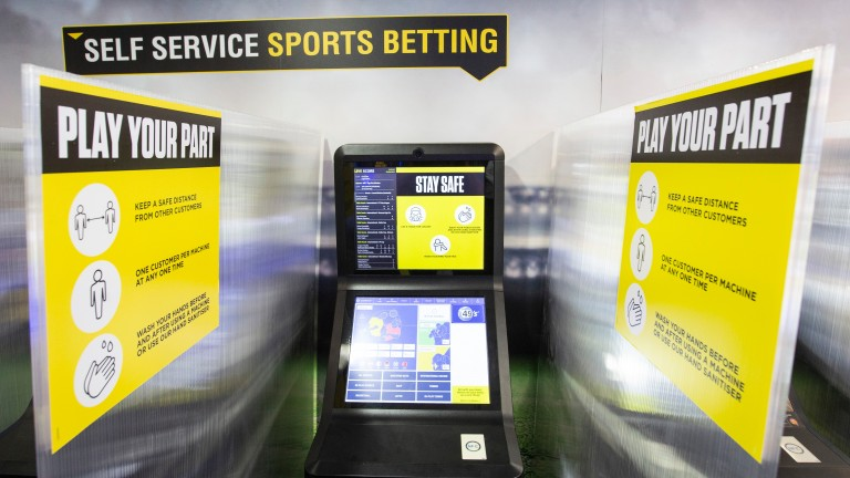 Betting terminals at Coral shops are divided by plastic screens