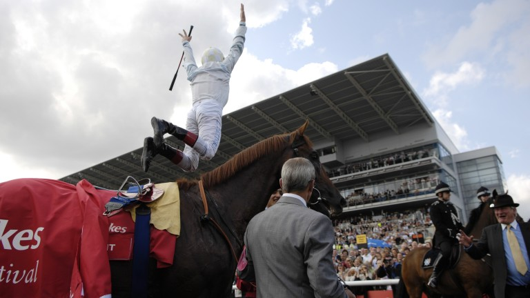 Frankie Dettori performs his trademark flying dismount after Conduit's St Leger triumph