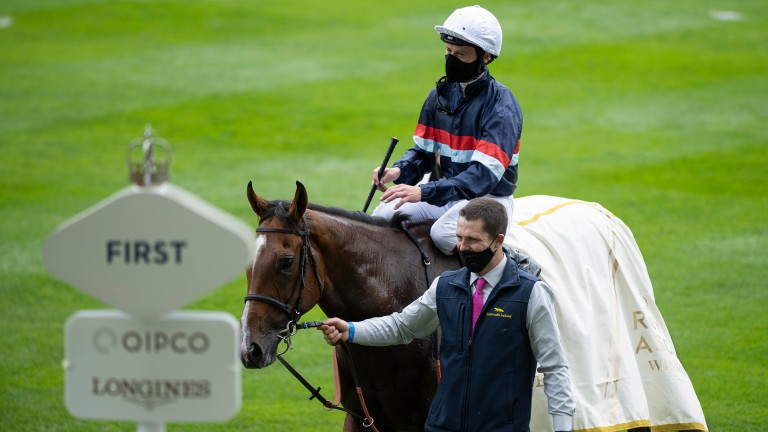 Sir Busker and Oisin Murphy are led into the winner's enclosure