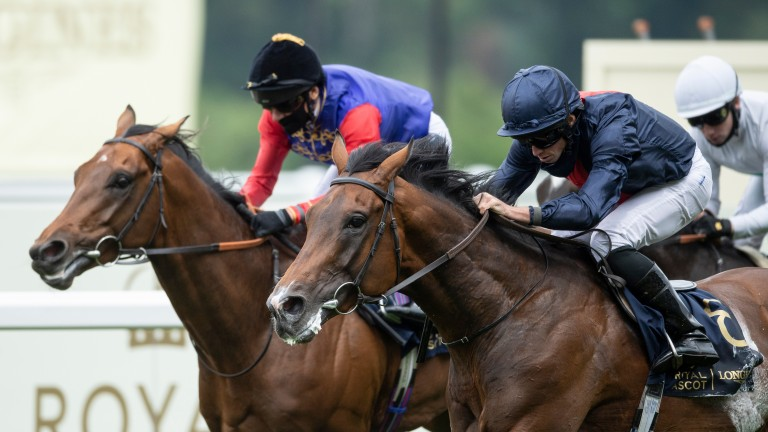 Russian Emperor and Ryan Moore (right) run down First Receiver to win the Hampton Court