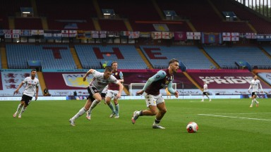 Jack Grealish of Aston Villa runs with the ball against Sheffield United at Villa Park