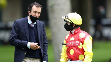 HAYDOCK, ENGLAND - JUNE 09: Andrea Atzeni talks to trainer Tom Clover prior to the Betway Handicap at Haydock Racecourse on June 09, 2020 in Haydock, England. (Photo by David Davies/Pool via Getty Images)
