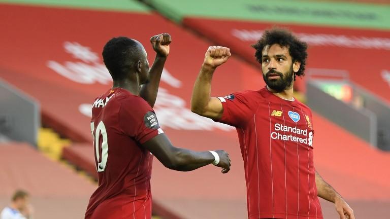 Liverpool's Mohamed Salah celebrates with Sadio Mane