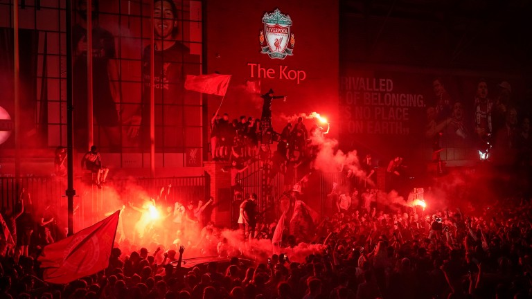 Liverpool fans celebrate winning the Premier League at Anfield