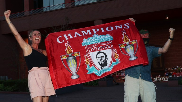 Liverpool fans celebrate as their team clinches the Premier League title