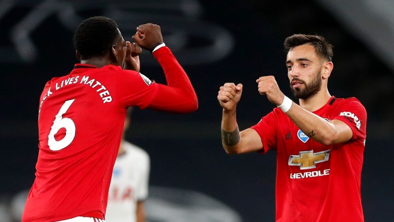 Manchester United's Bruno Fernandes of celebrates with teammate Paul Pogba