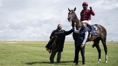 Oisin Murphy celebrates after winning the QIPCO 2,000 Guineas on Qatar Racing's Derby contender Kameko