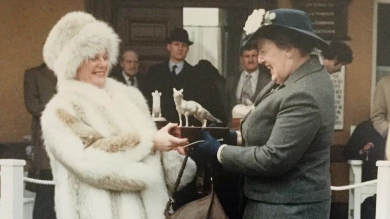 Anne Tory (right) receiving the trophy for the 1983 Lincoln Handicap won by Mighty Fly