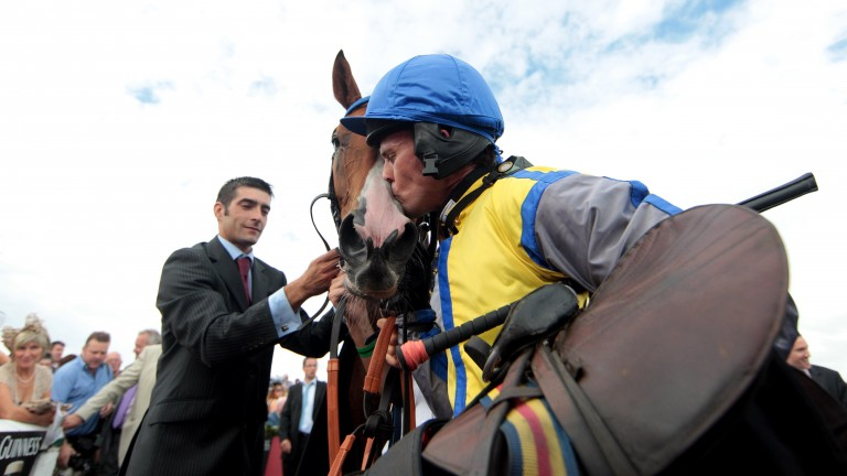 Graham Lee gives Overturn a kiss after his galiant victory in the Galway Hurdle