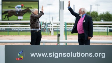 Neil Biggs (left) one of the syndicate of Foxtrot racing  receives a socially distanced hands five from Arena chairman David Thorpe aftet Ultimate Getaway had won the signsolutions.org Event Signage National Hunt Flat raceSouthwell racecourse, 1.7.20 Pic: