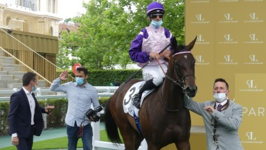 Livachope and Anthony Crastus return to the winners' enclosure after the Prix du Bois at Longchamp