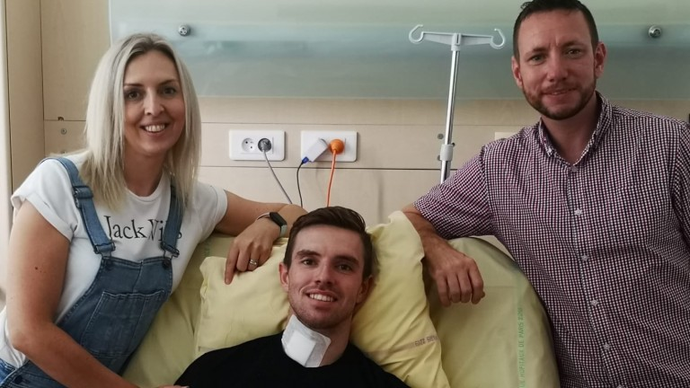 Jacob Pritchard Webb with mum Kelly and dad Matt by his bedside in a Paris hospital following a fall at Auteuil