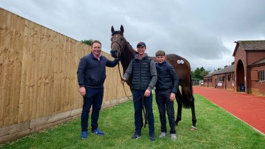 Brian Slattery (from left) with Luke and Jake Coen and the sales-topping Excelebration colt