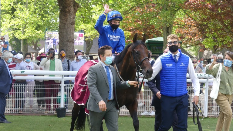 Pinatubo and William Buick return to the winner's enclosure after scoring in the Prix Jean Prat at Deauville