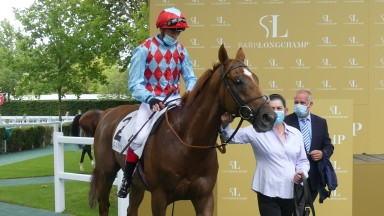 Red Verdon and Frankie Dettori return to the winners' enclosure after scoring in the Prix Maurice de Nieuil at Longchamp