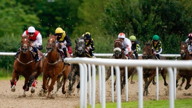 WOLVERHAMPTON, ENGLAND - JULY 02: Hollie Doyle riding Savalas (R, grey horse) win The Sky Sports Racing On Sky 415 Handicap at Wolverhampton Racecourse on July 02, 2020 in Wolverhampton, England. Horseracing continues behind closed doors due to the Corona