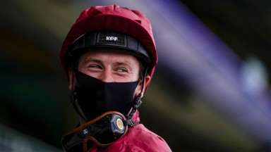 The smile is in the eyes: Oisin Murphy can't conceal his joy after The Lir Jet wins the Norfolk Stakes at Ascot