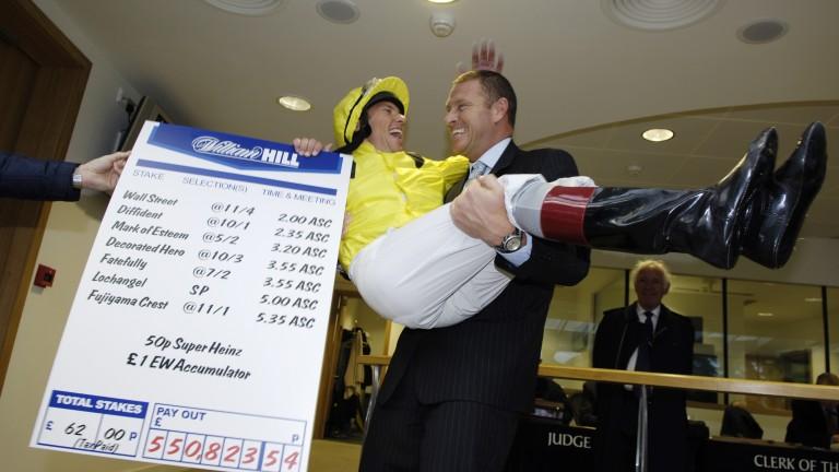 Good publicity: punter Darren Yates celebrates winning half a million pounds on his hero Frankie Dettori's greatest day