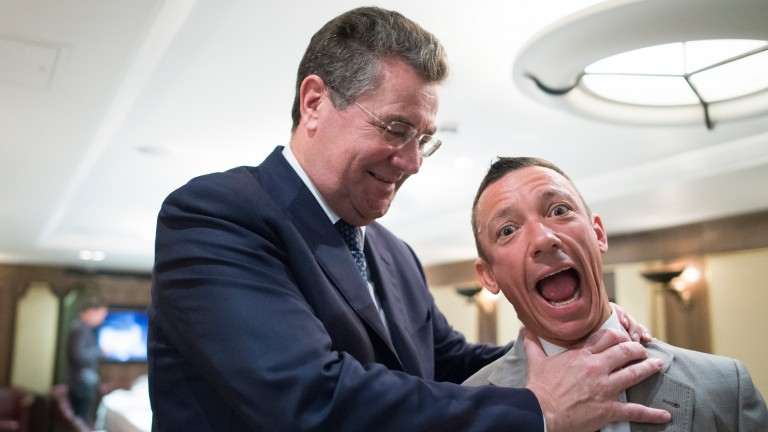 No hard feelings: Mike Dillon of Ladbrokes shakes Frankie Dettori warmly by the throat on the 20th anniversary of the Magnificent Seven