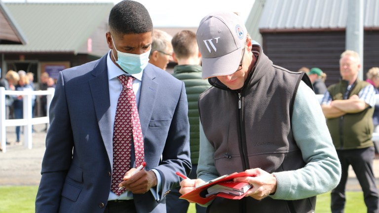 Matt Coleman signs the docket for the £70,000 Midnight Legend filly