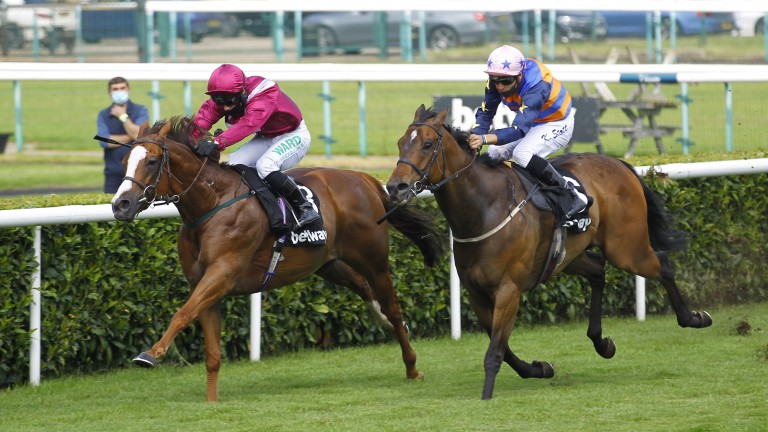 El Astronaute and Jason Hart (left) fend off Tarboosh to win the Achilles Stakes at Doncaster