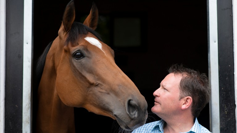 Ed Vaughan stands with stable star Dame Malliot