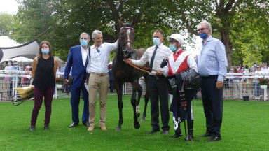 Winning team: owners Claudio Marzocco (blue suit, second left) and Bernard Benaych (white shirt, patting horse) with Port Guillaume, Cristian Demuro and Jean-Claude Rouget after the Prix Hocquart Longines at Deauville