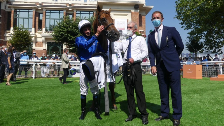 William Buick and Charlie Appleby flank Space Blues after winning the Prix Maurice de Gheest at Deauville on Sunday