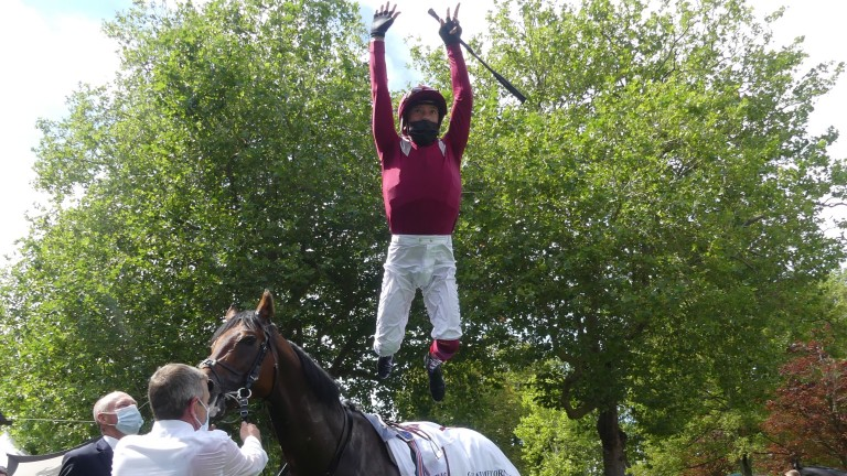 Half the job is done: Frankie Dettori celebrates success on Mishriff in the Prix Guillaume d'Ornano at Deauville, a ride which means he will have to serve quarantine on his return to the UK