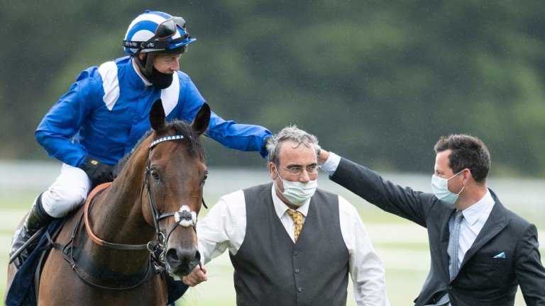 Battaash (Jim Crowley) fist pumps with trainer Charlie Hills as groom Bob Grace meets his horse after the Coolmore Nunthorpe StakesYork 21.8.20 Pic: Edward Whitaker/Racing Post