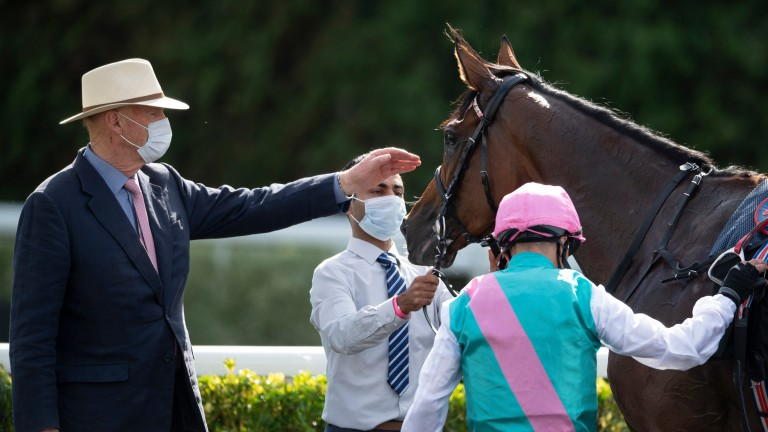 John Gosden greets Enable after the September Stakes at Kempton