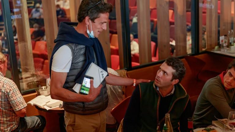 Henri Bozo of Ecurie des Monceaux congratulates Sebastien Desmontils (right) after purchasing lot 157 for €630,000