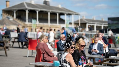 Rare sight: spectators enjoy the sunshine on day one of the St Leger meeting at Doncaster. Racegoers were stopped from attending the final three days of the fixture by public health officials