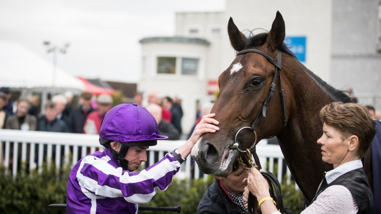 Sergei Prokofiev receives an appreciative pat from Ryan Moore after winning the Rochestown Stakes by four lengths