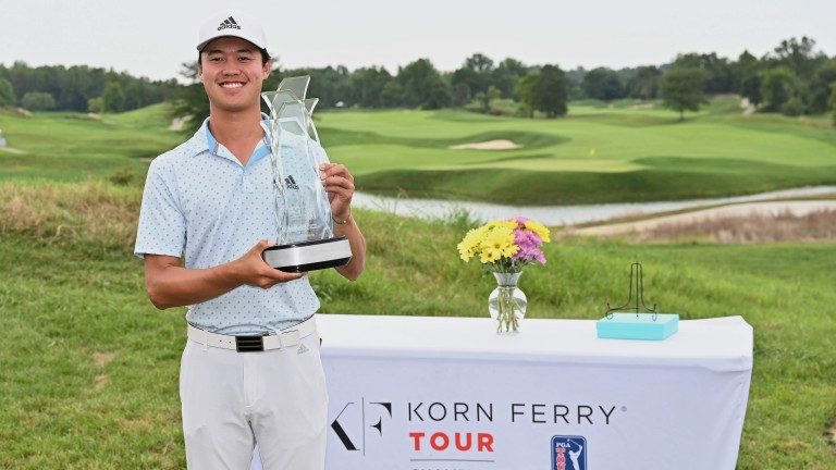 Brandon Wu poses with the trophy after winning the Korn Ferry Tour Championship at Victoria National Golf Club