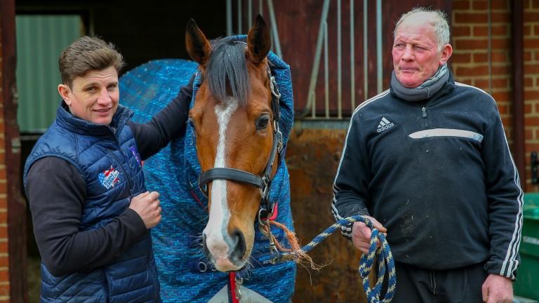 Goshen: flanked by jockey Jamie Moore and trainer Gary Moore