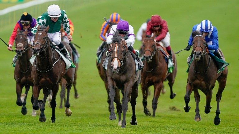 Supremacy (white and purple) wins the Juddmonte Middle Park at Newmarket for Adam Kirby and Clive Cox