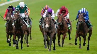 NEWMARKET, ENGLAND - SEPTEMBER 26: Adam Kirby riding Supremacy (white/purple) win The Juddmonte Middle Park Stakes at Newmarket Racecourse on September 26, 2020 in Newmarket, England. Owners are allowed to attend if they have a runner at the meeting other