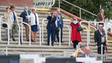 Owners watch the action at a behind-closed-doors meeting at Goodwood