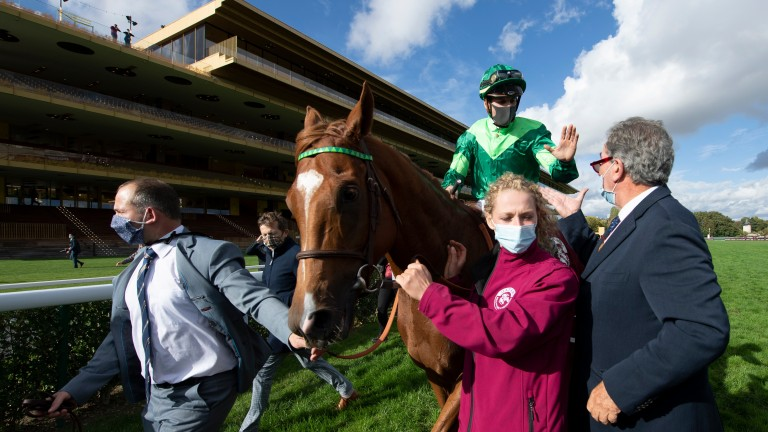 Sottsass and Cristian Demuro are led in after winning the 2020 Prix de l'Arc de Triomphe