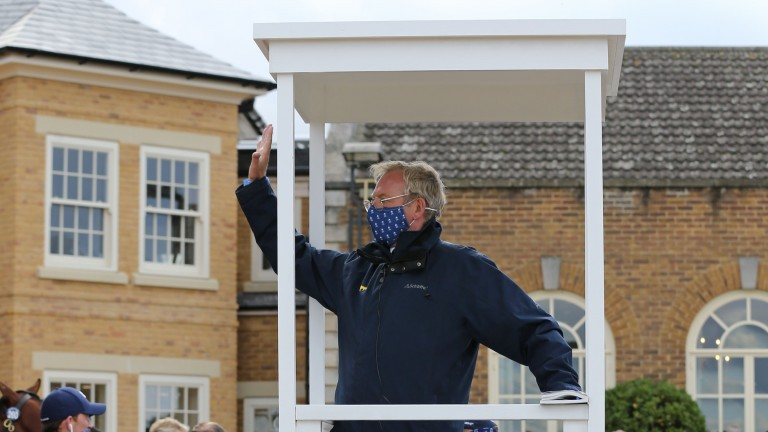 Richard Botterill signals a bid from the podium by the parade ring